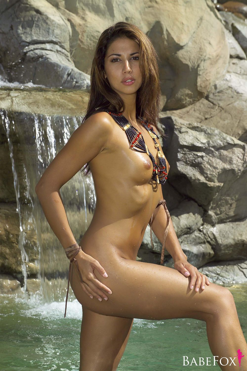 Leilani Dowding posing naked on the beach