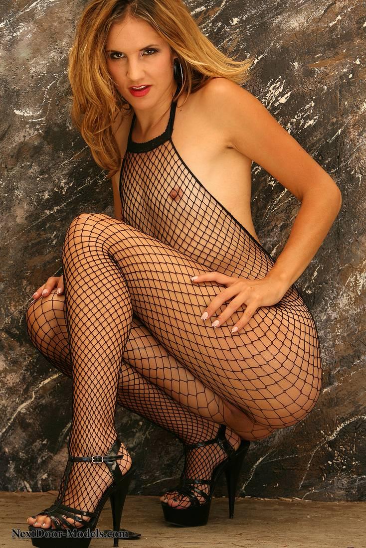 Long legged Eva Paige wears black fishnet